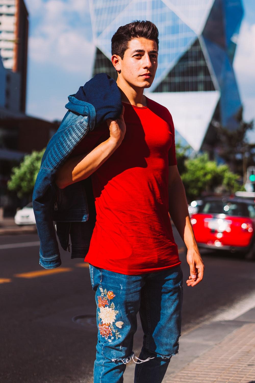 man carrying blue jacket