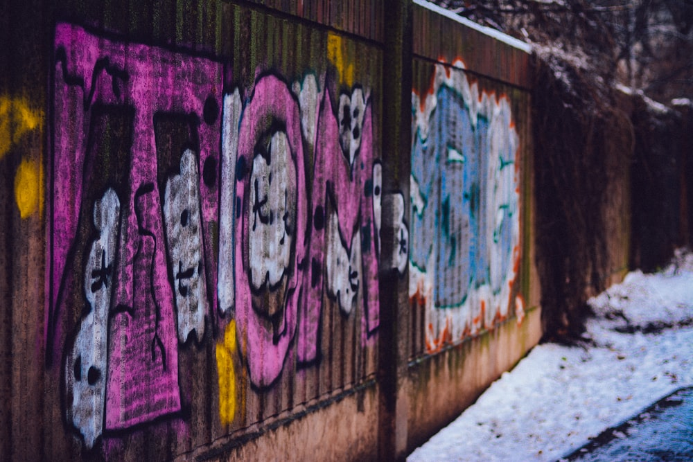 pink and blue graffiti on the wall