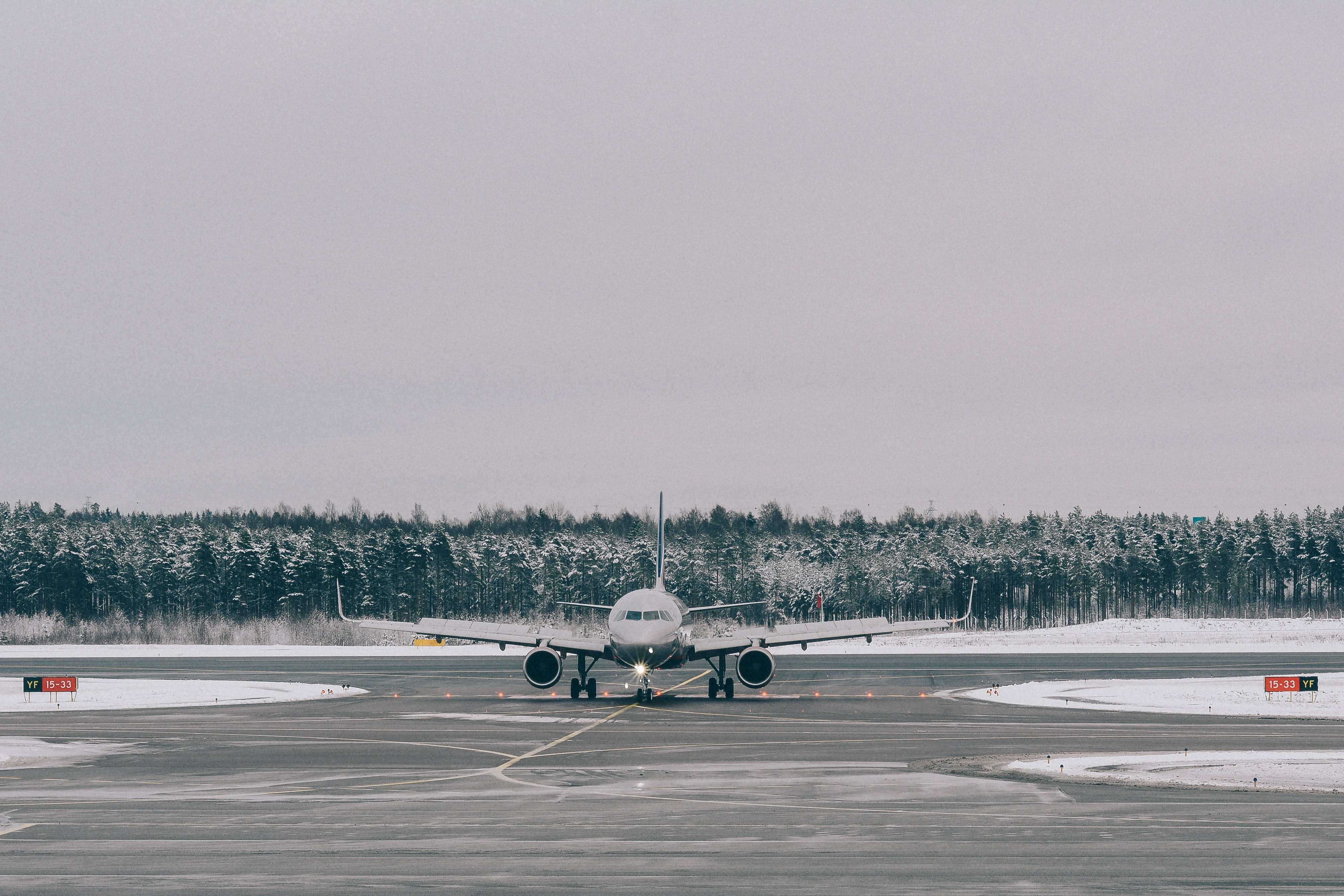 gray airplane on field