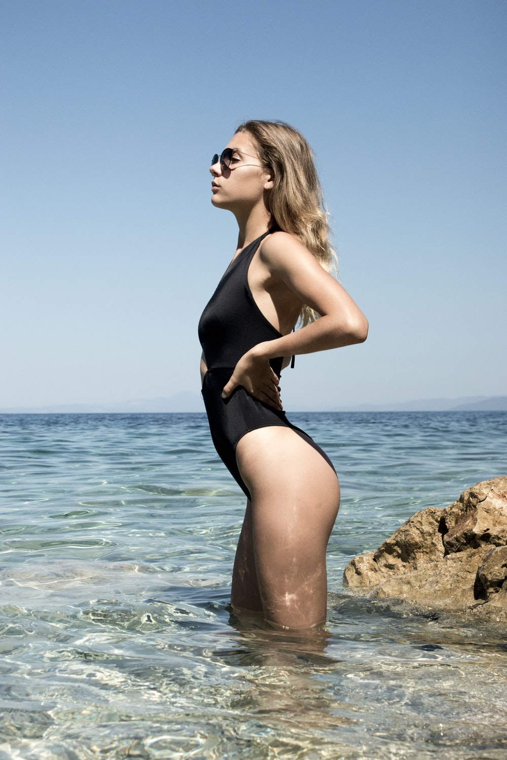 woman on sea standing and posing