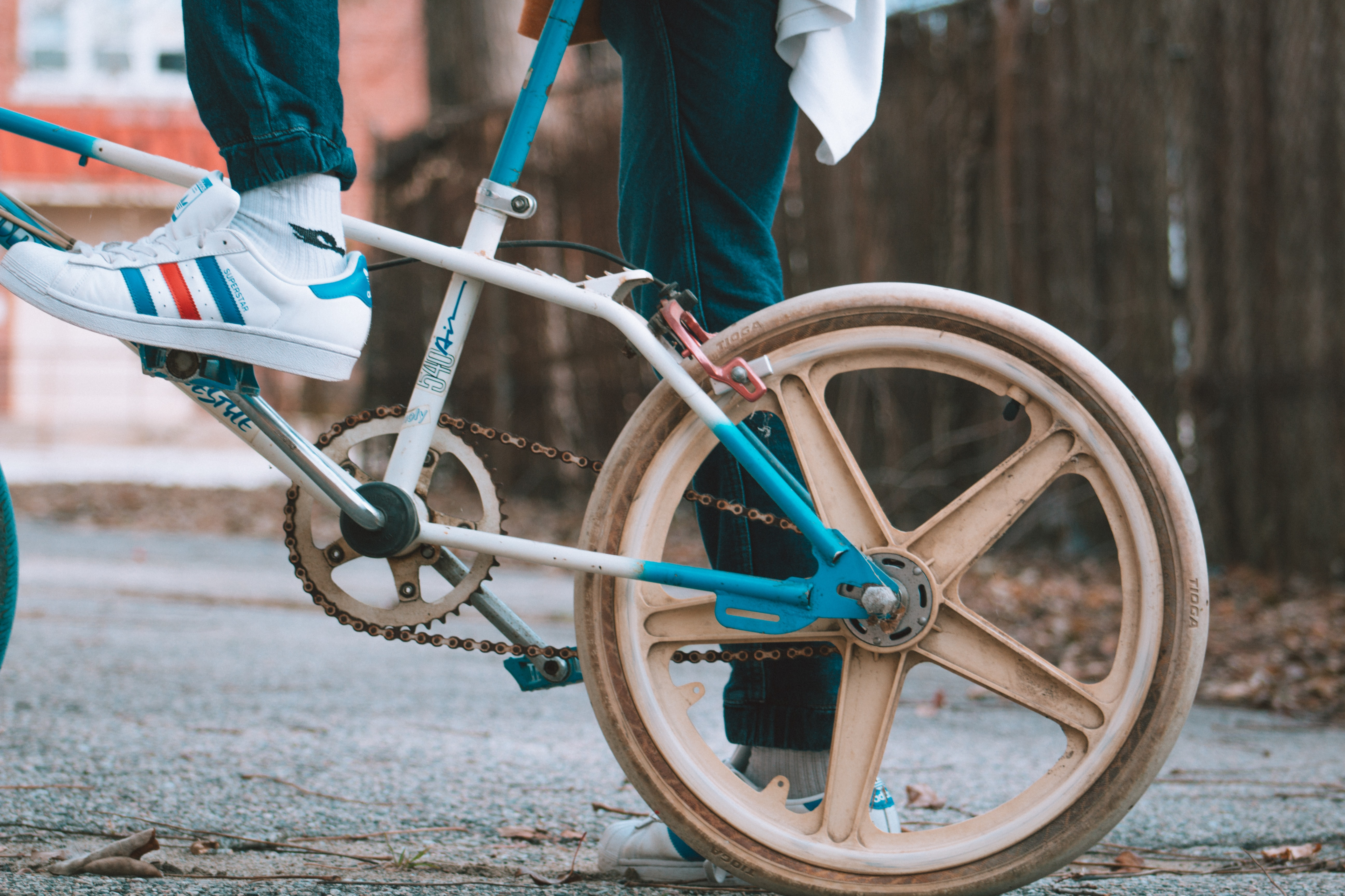 selective focus photo of person riding bicycle