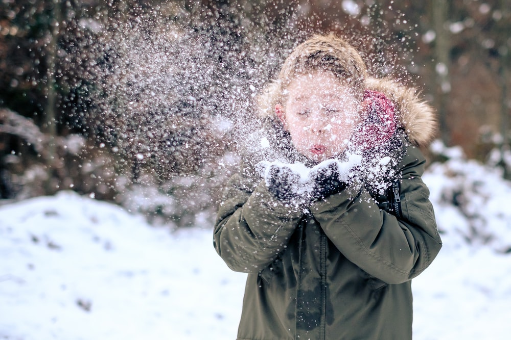 person blowing snow