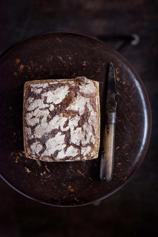 bread beside knife on chair