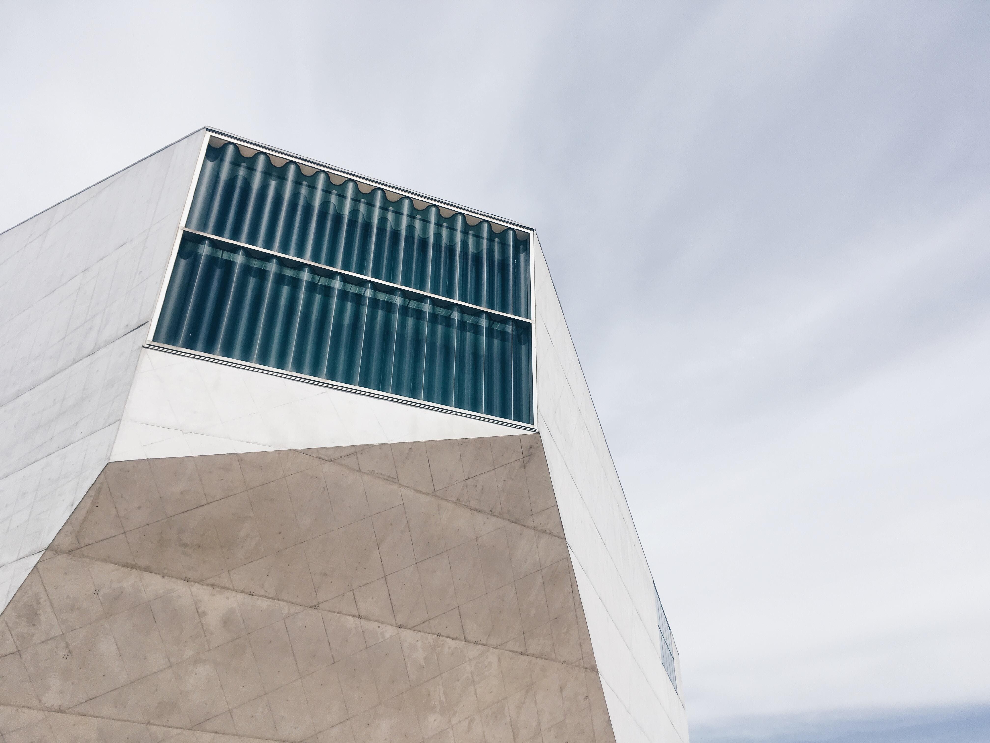 gray concrete building taken under white cloud during daytime