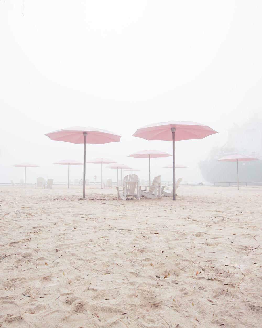 pink canopy umbrellas in beach