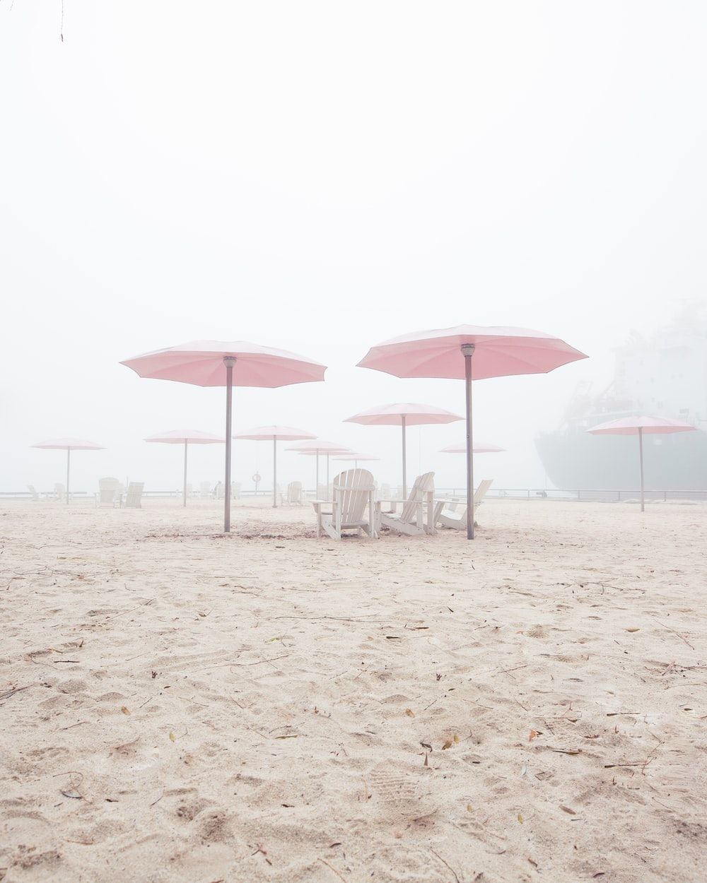 pink canopy umbrellas in beach