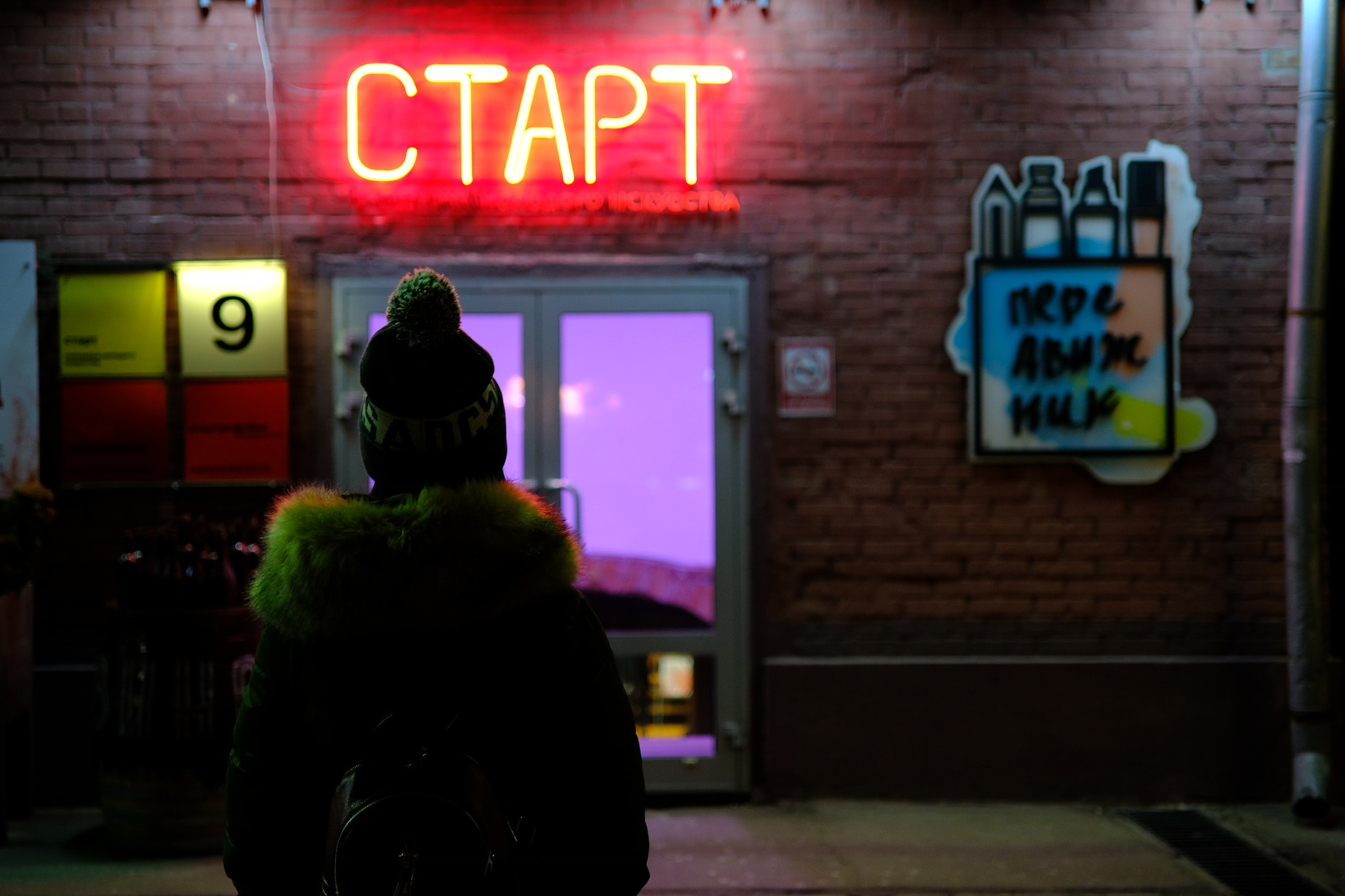 person standing on neon sigange