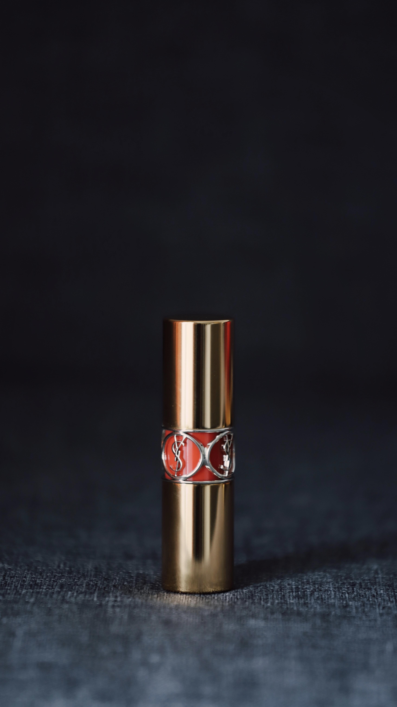 lipstick bottle on gray surface