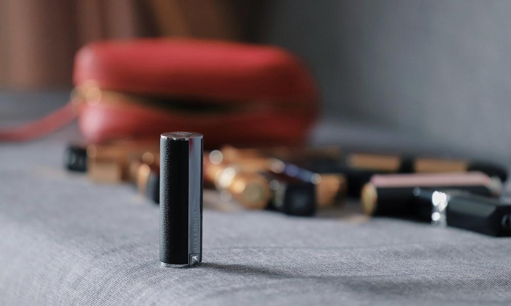 gray tube on sofa