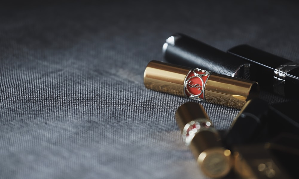 lipsticks on gray panel