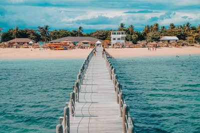 photo of brown wooden dock towards beach philippines teams background