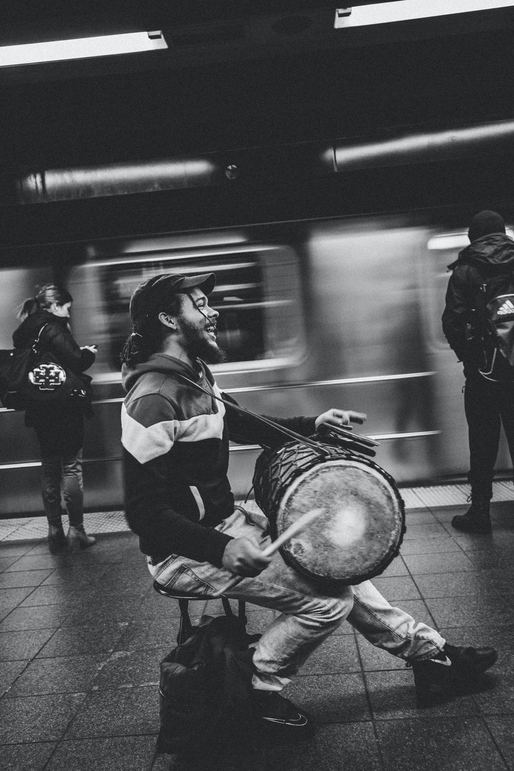 man playing drum in subway