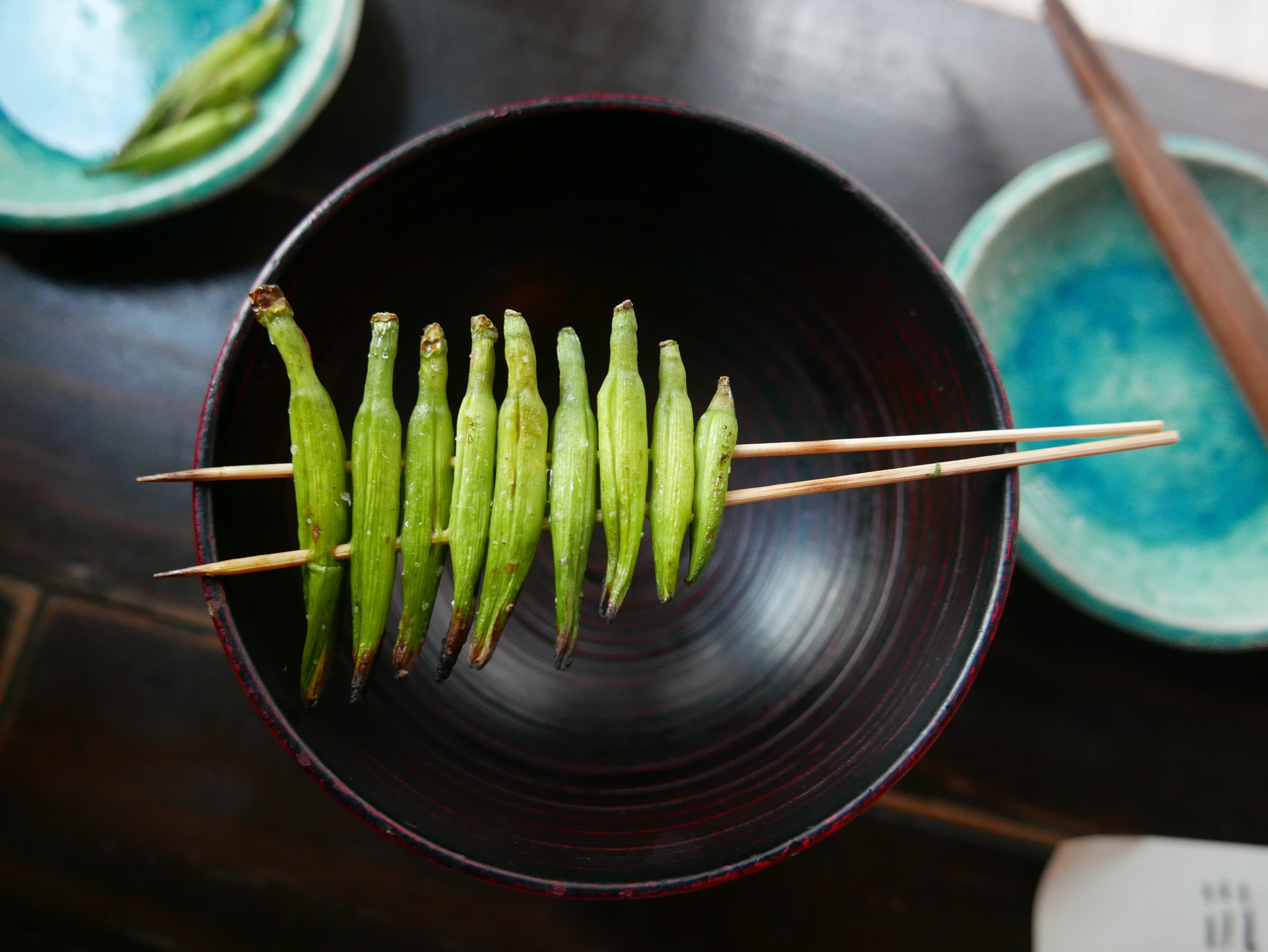 green ladyfingers skewer in wooden sticks