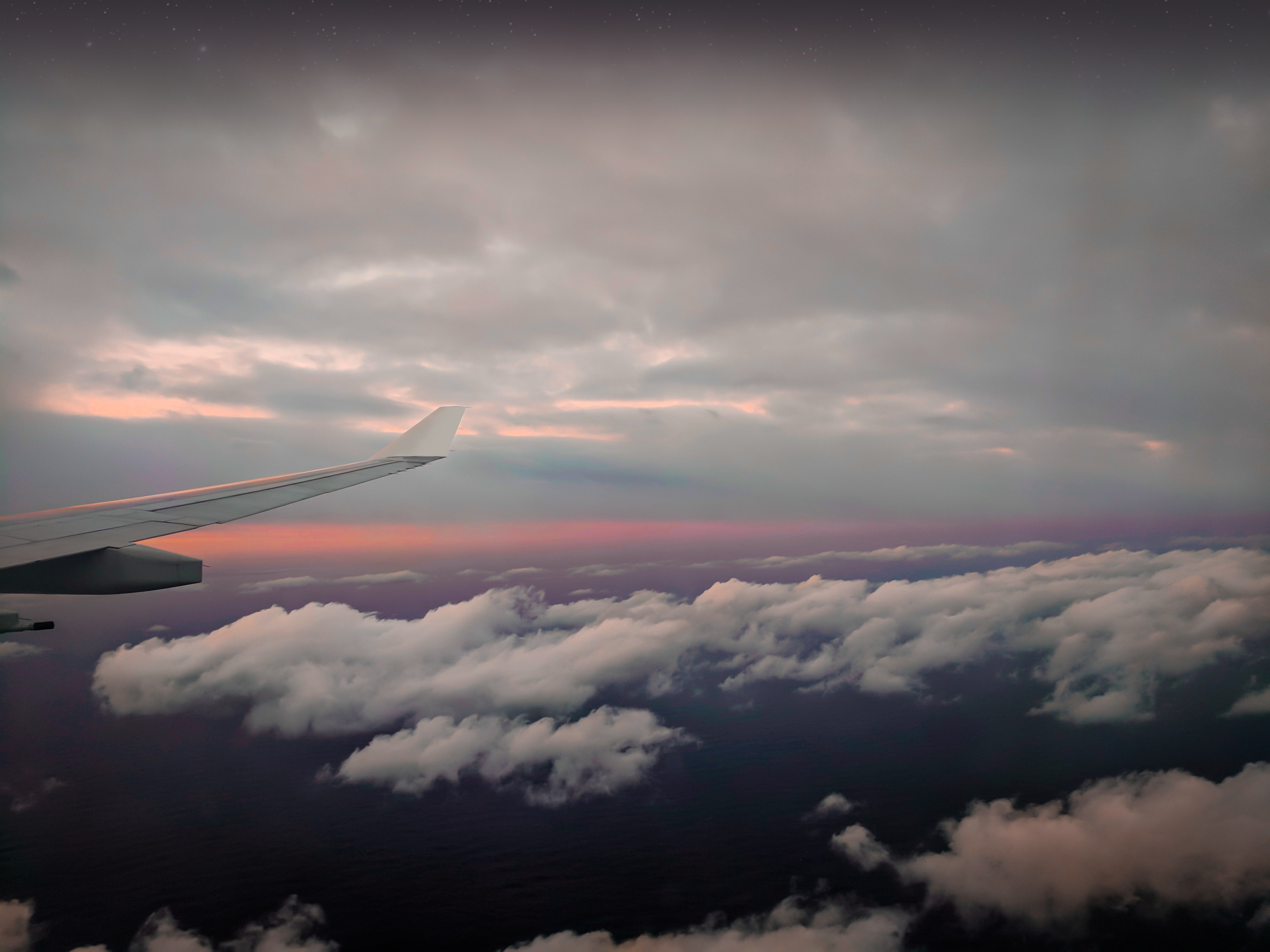 aerial photography of clouds from airplane