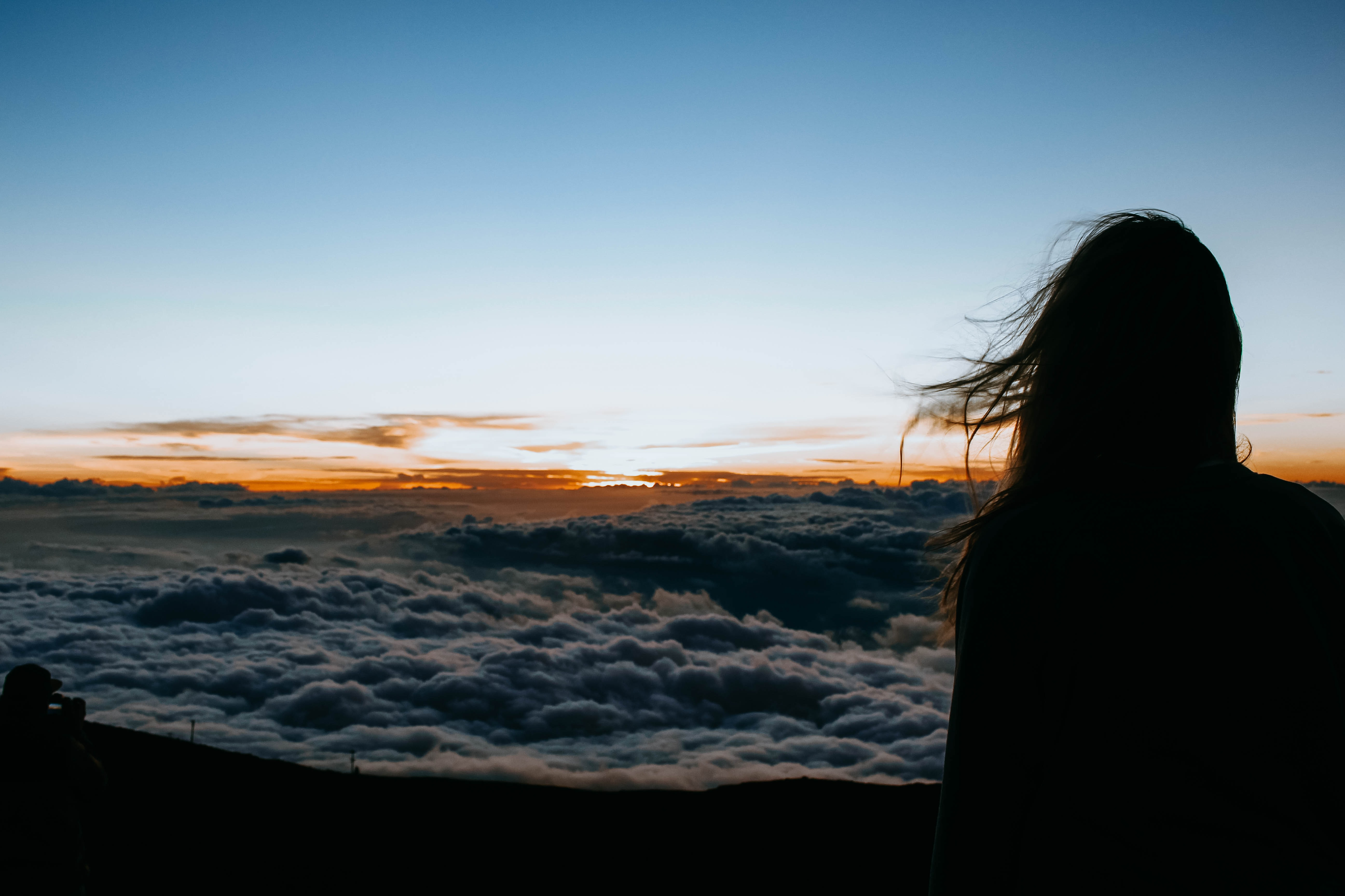 person overlooking clouds