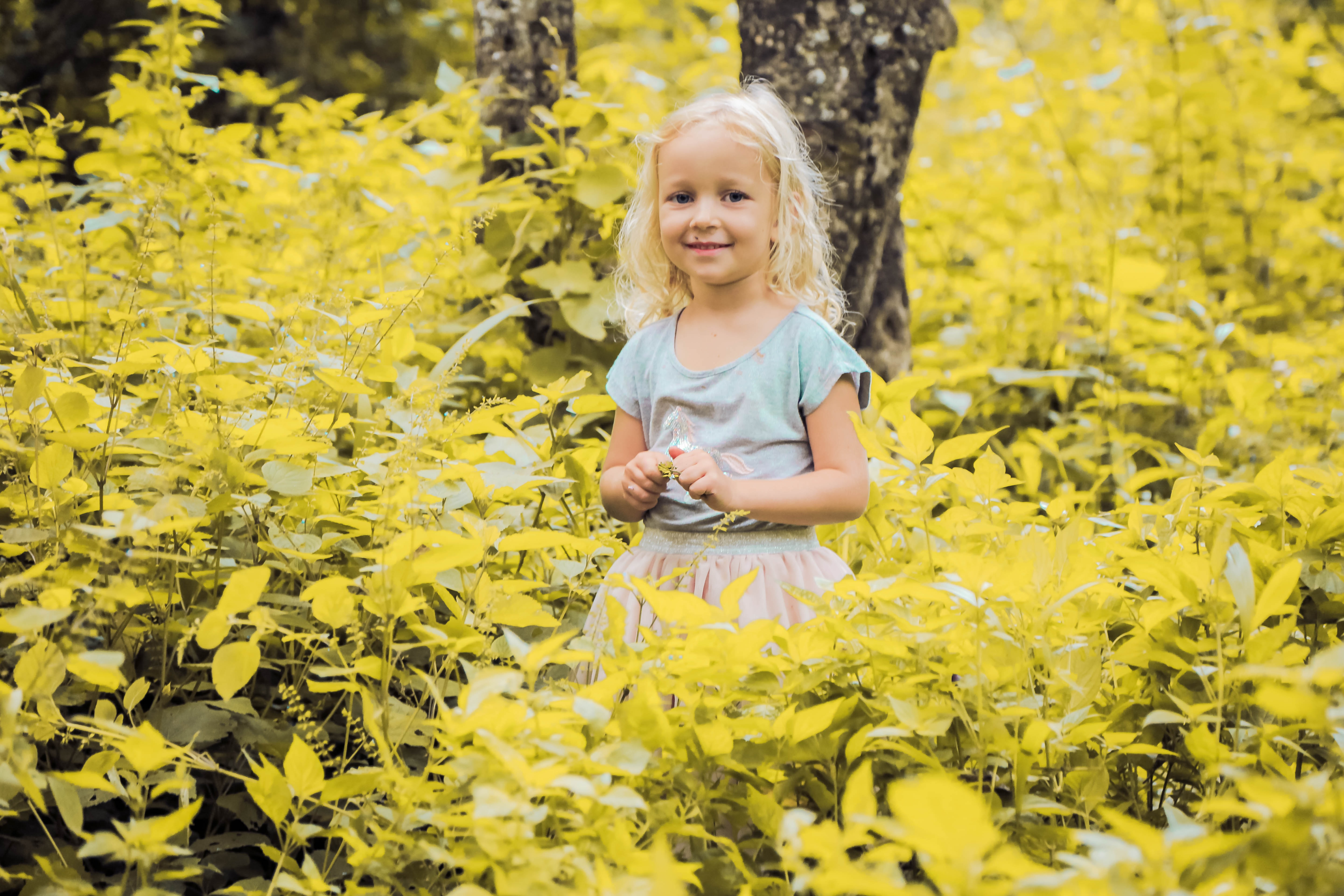 girl in yellow plant field