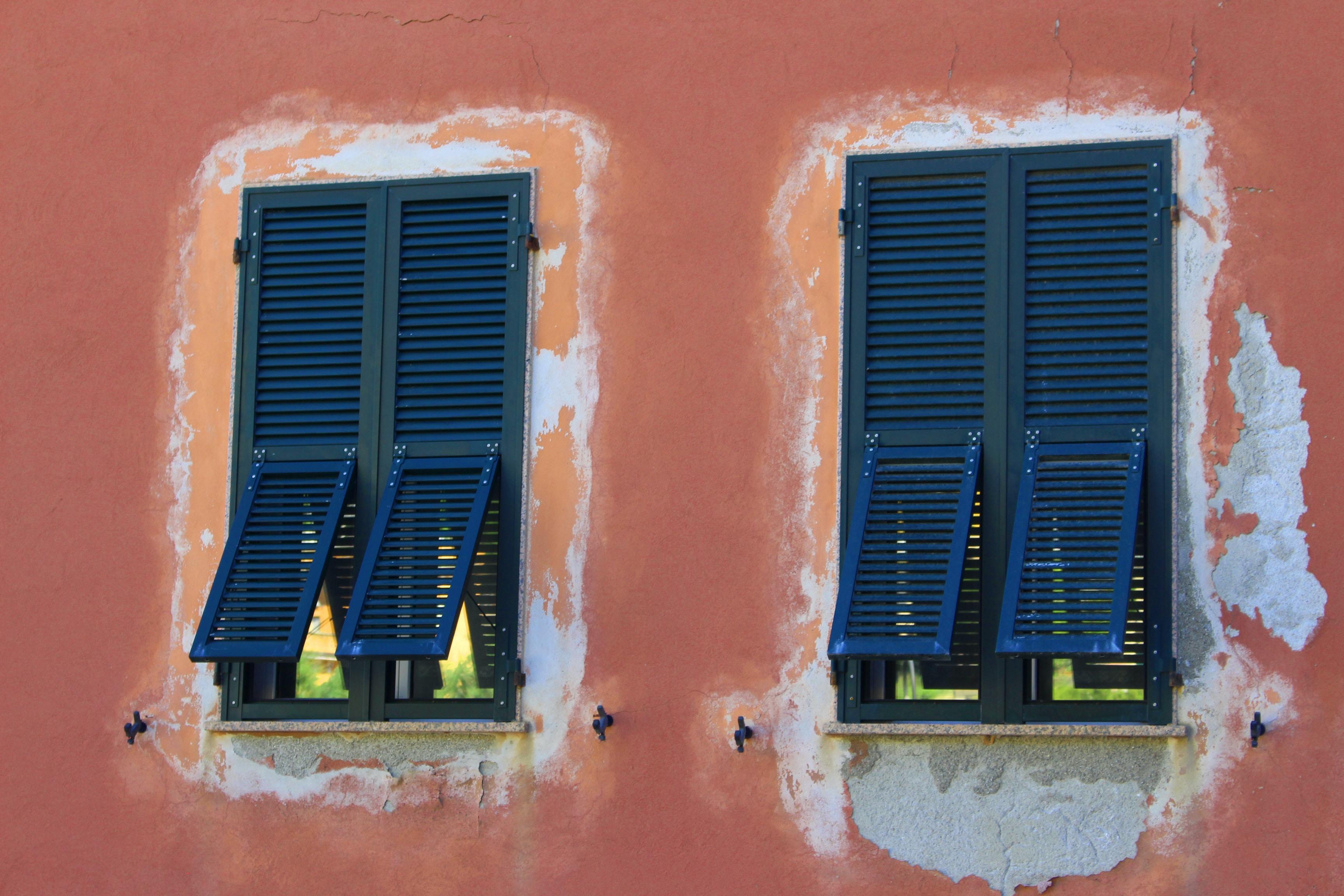 two blue windows on orange wall