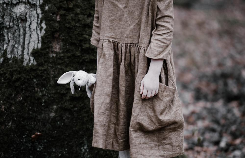 person holding rabbit