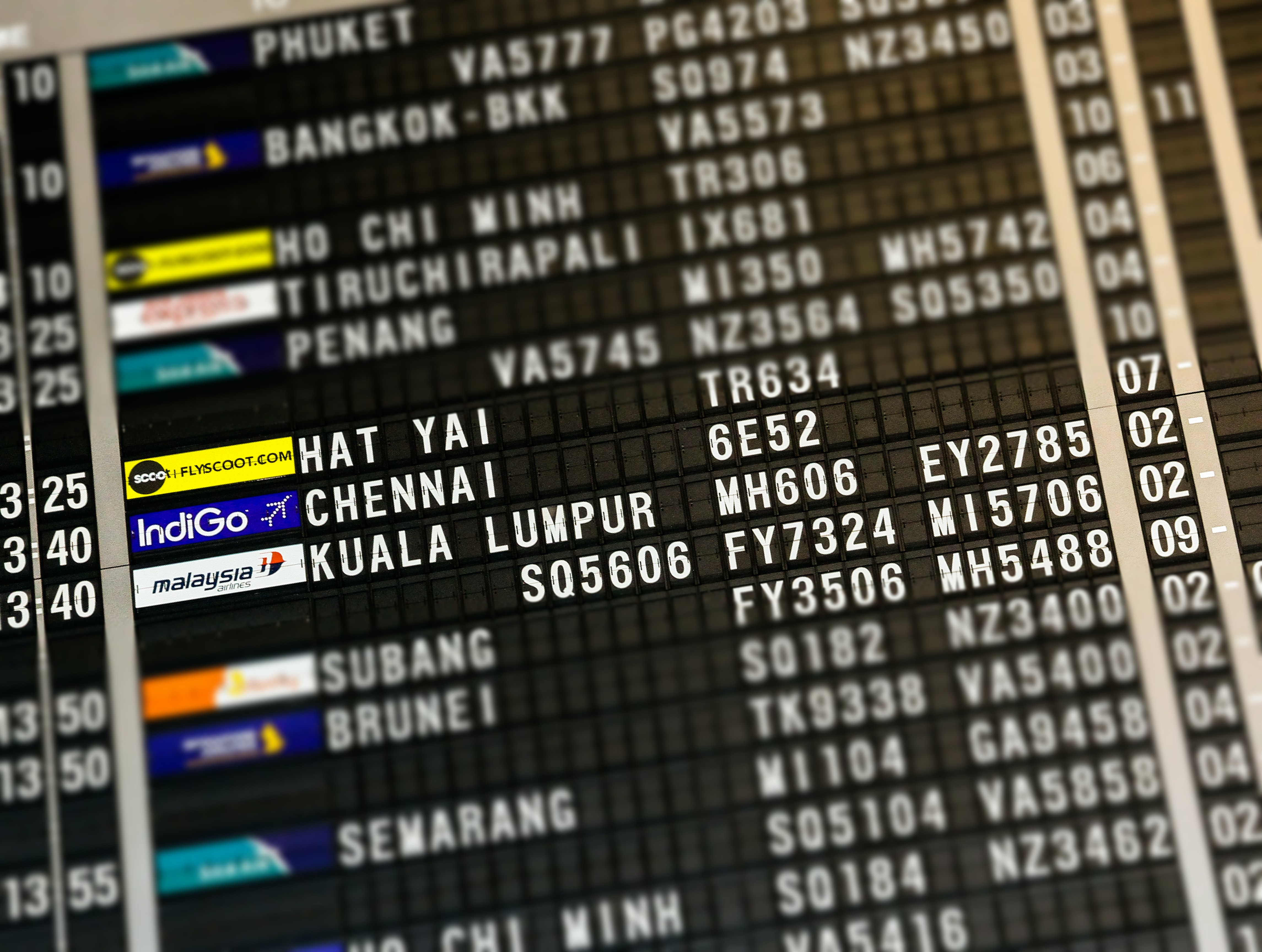 flight board highlighting Hat Yai, Chennai, and Kuala Lumpur