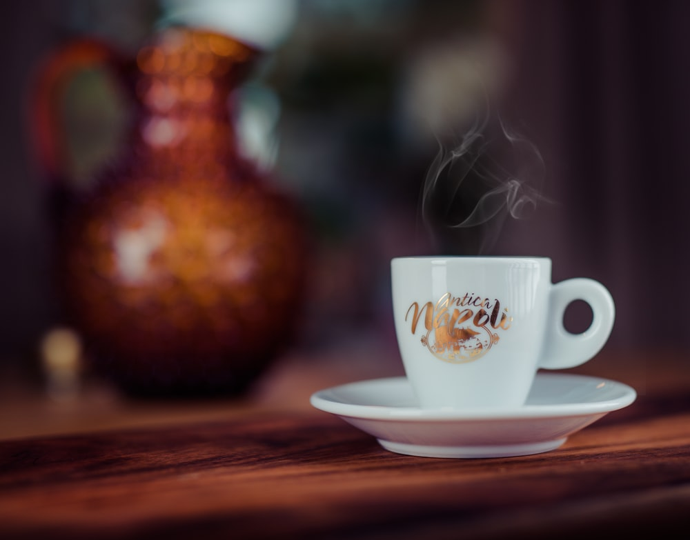 shallow focus photography of white ceramic teacup