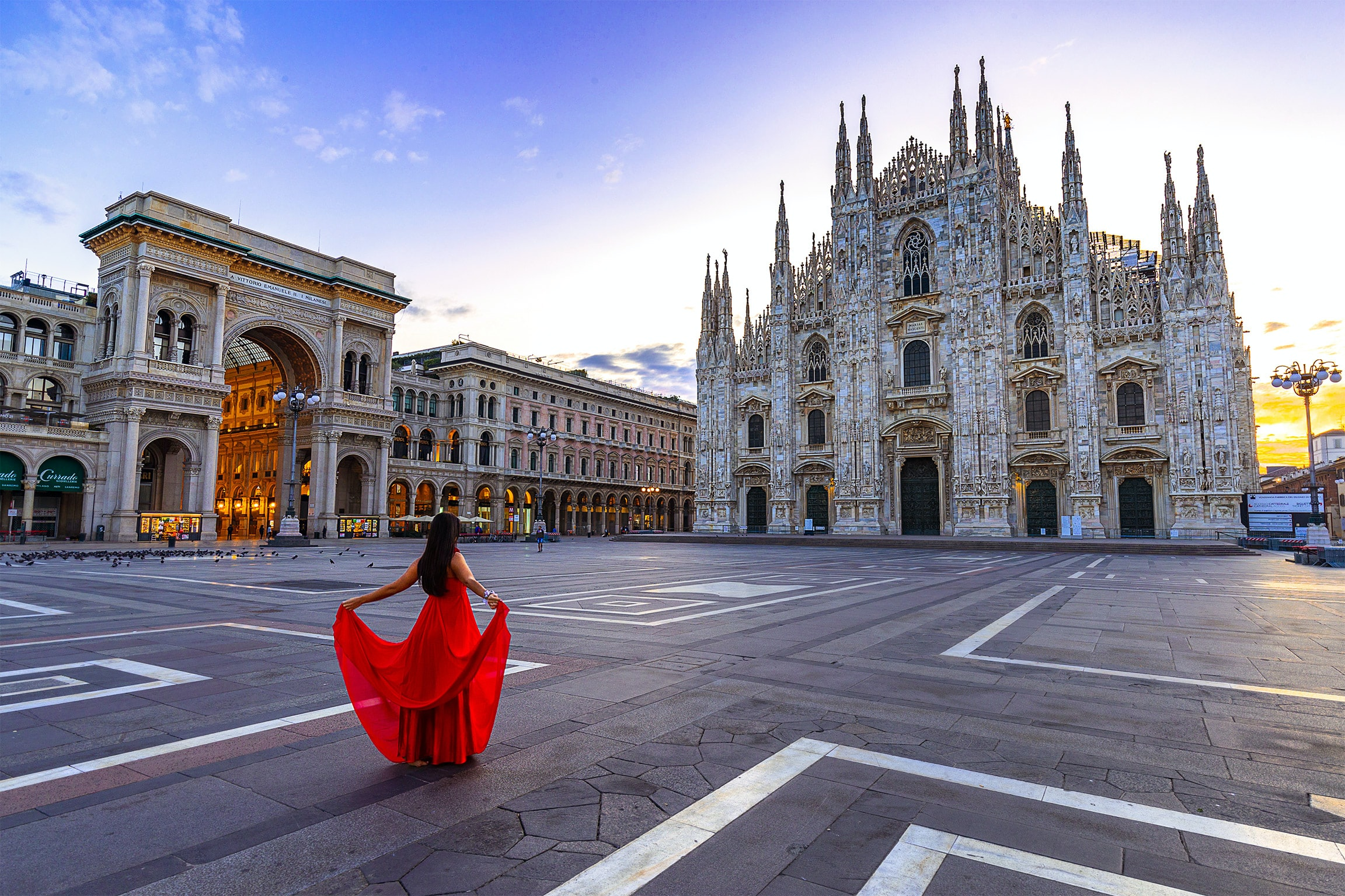 woman wearing red gown facing at cathedral