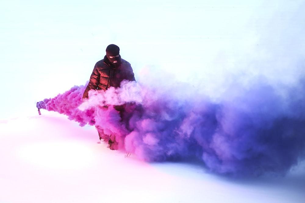 person walking on purple smoke