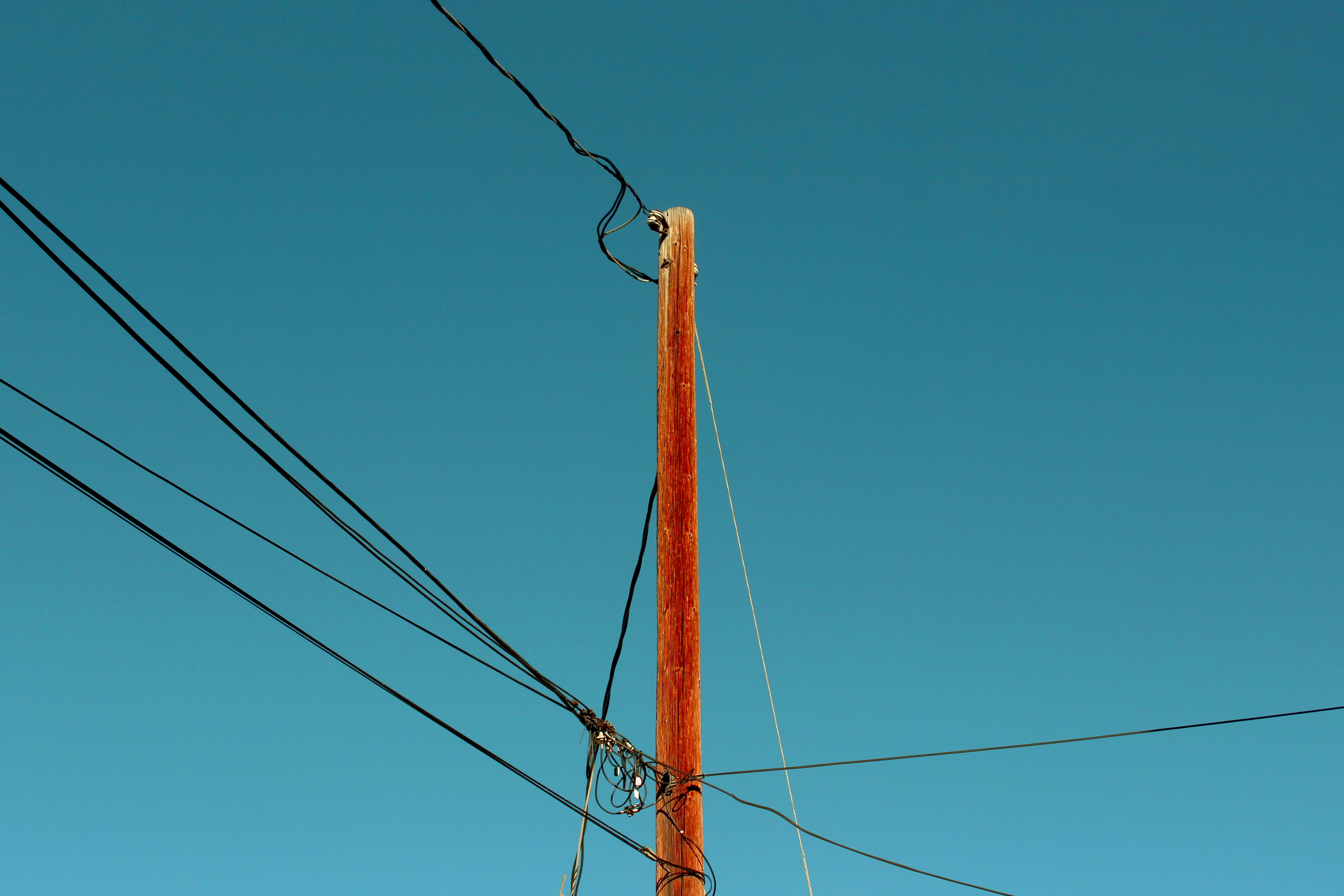 photo of brown electric post