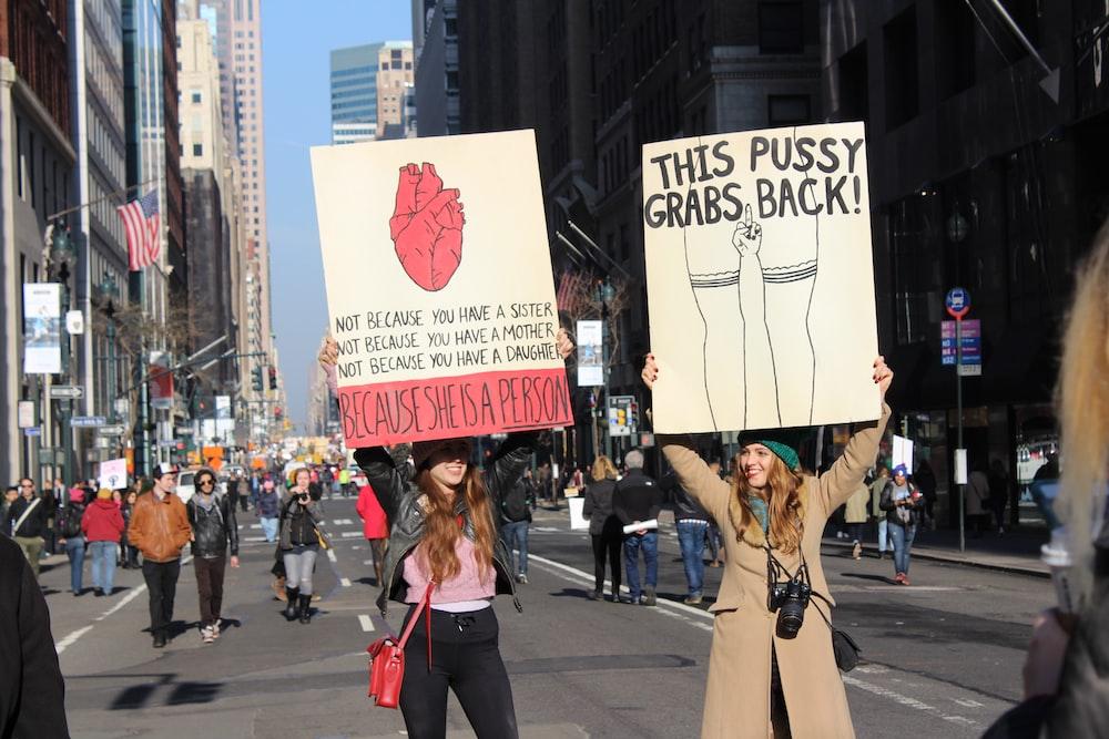 two women raising banners