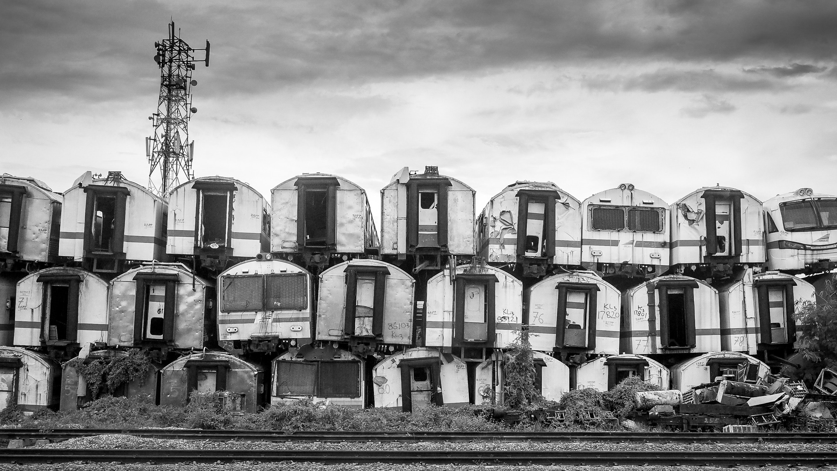 grayscale photography of piling of container vans