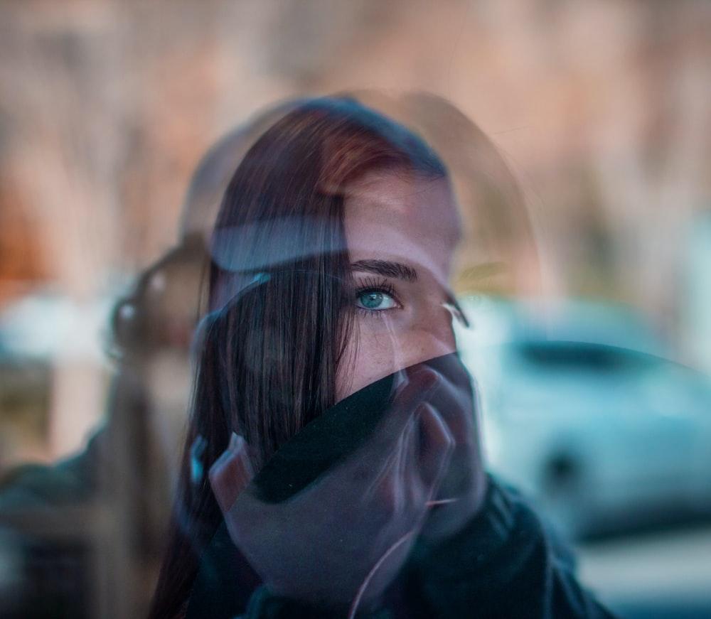 person using DSLR camera capturing woman