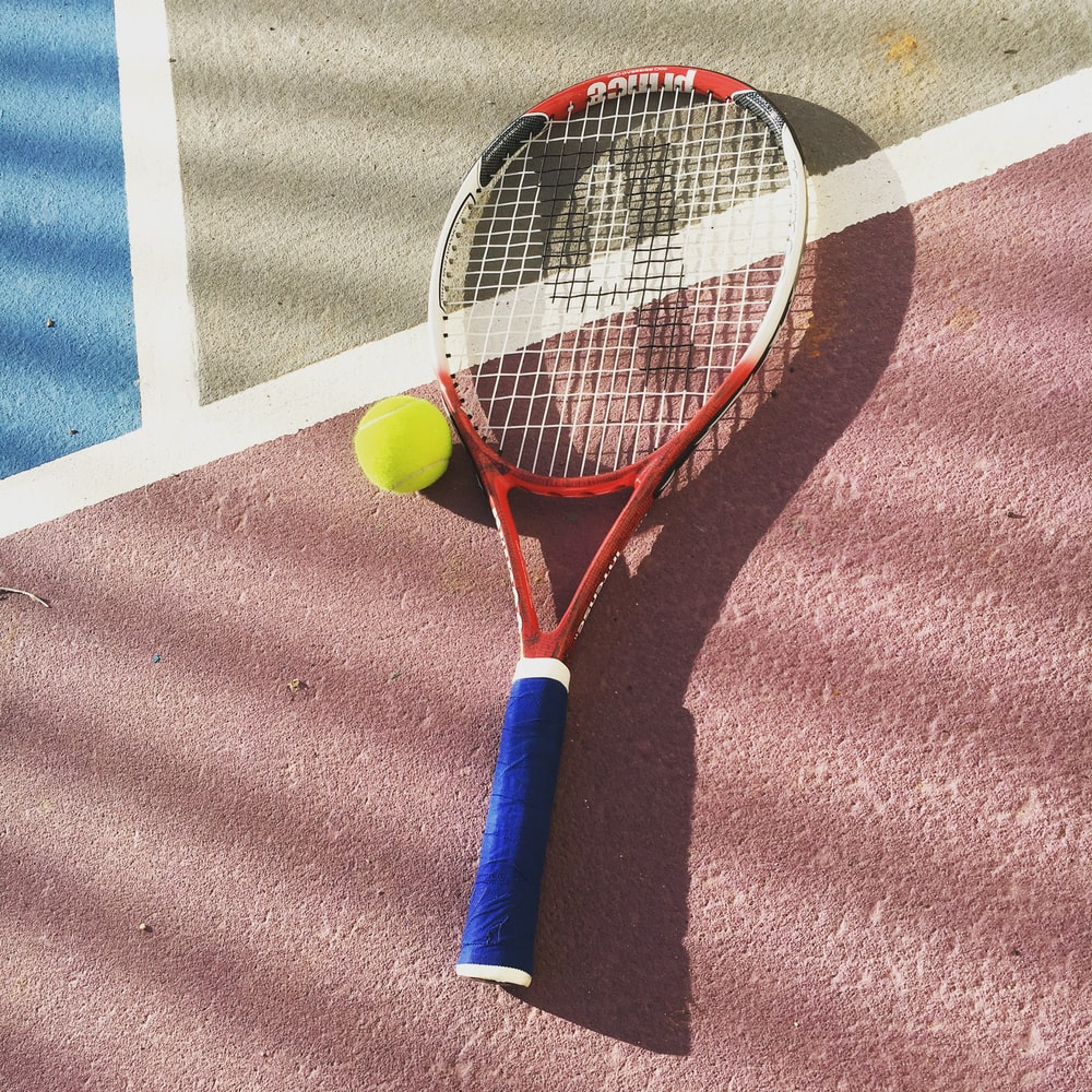 yellow and white tennis racket