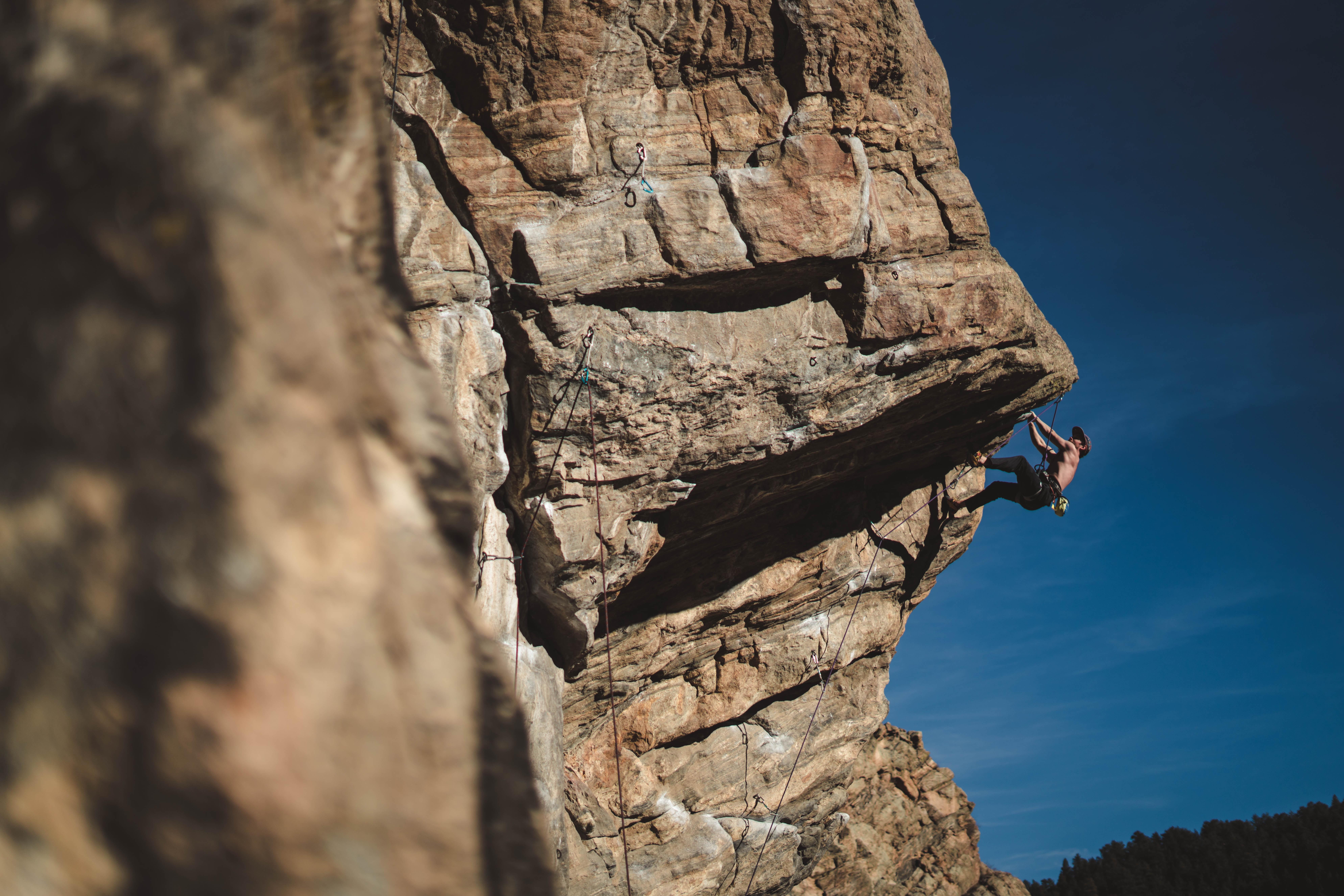 person climbing hills
