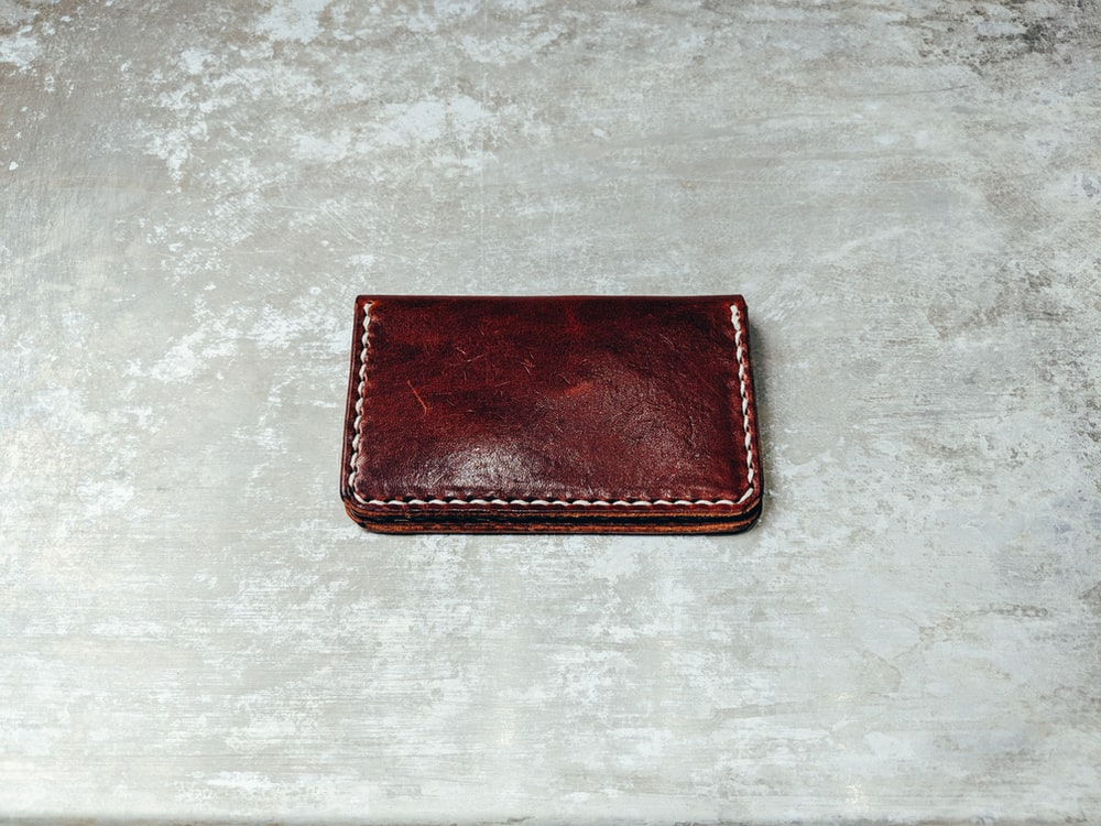 photo of brown leather bifold wallet