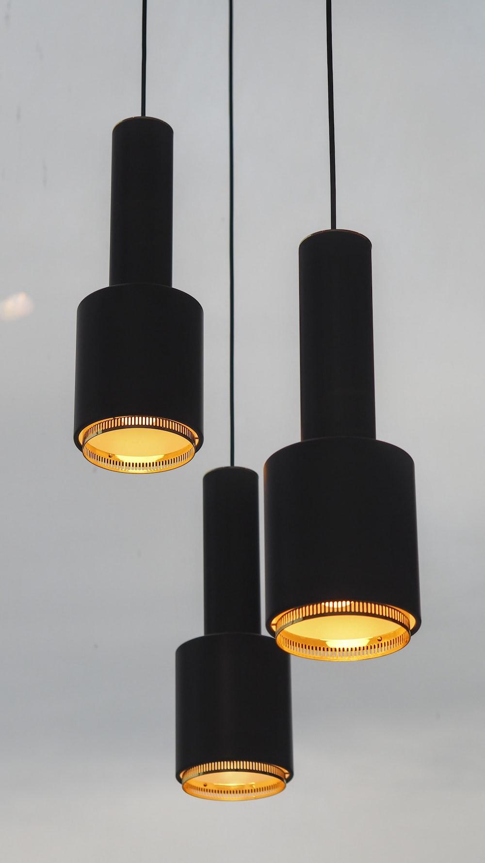 three black pendant lamps