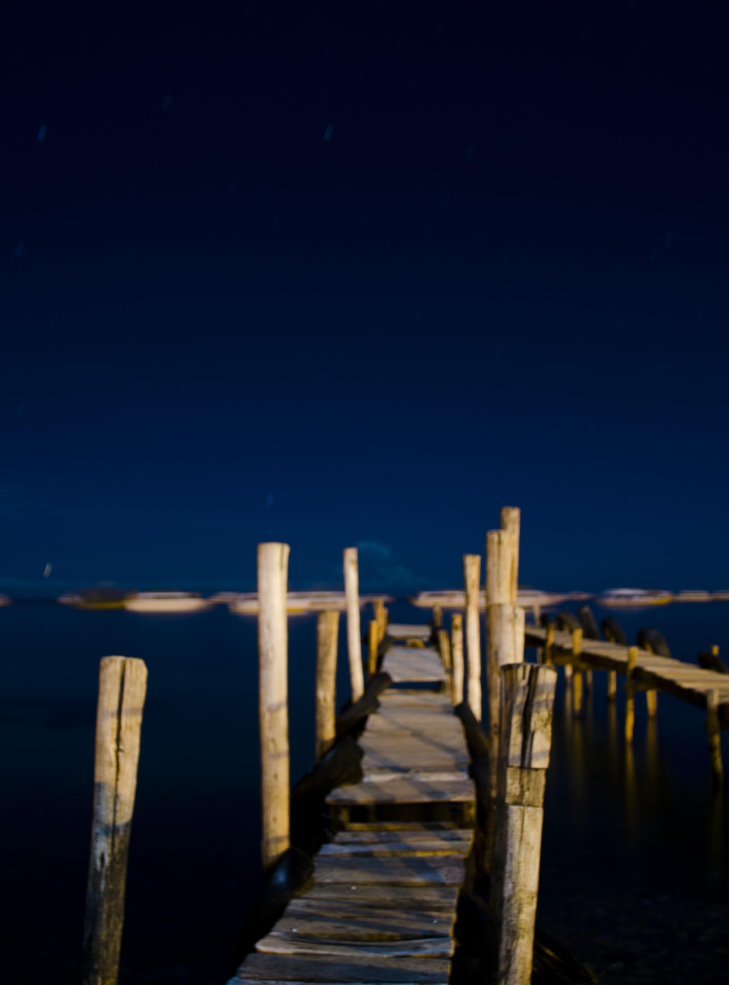 brown dock during nighttime
