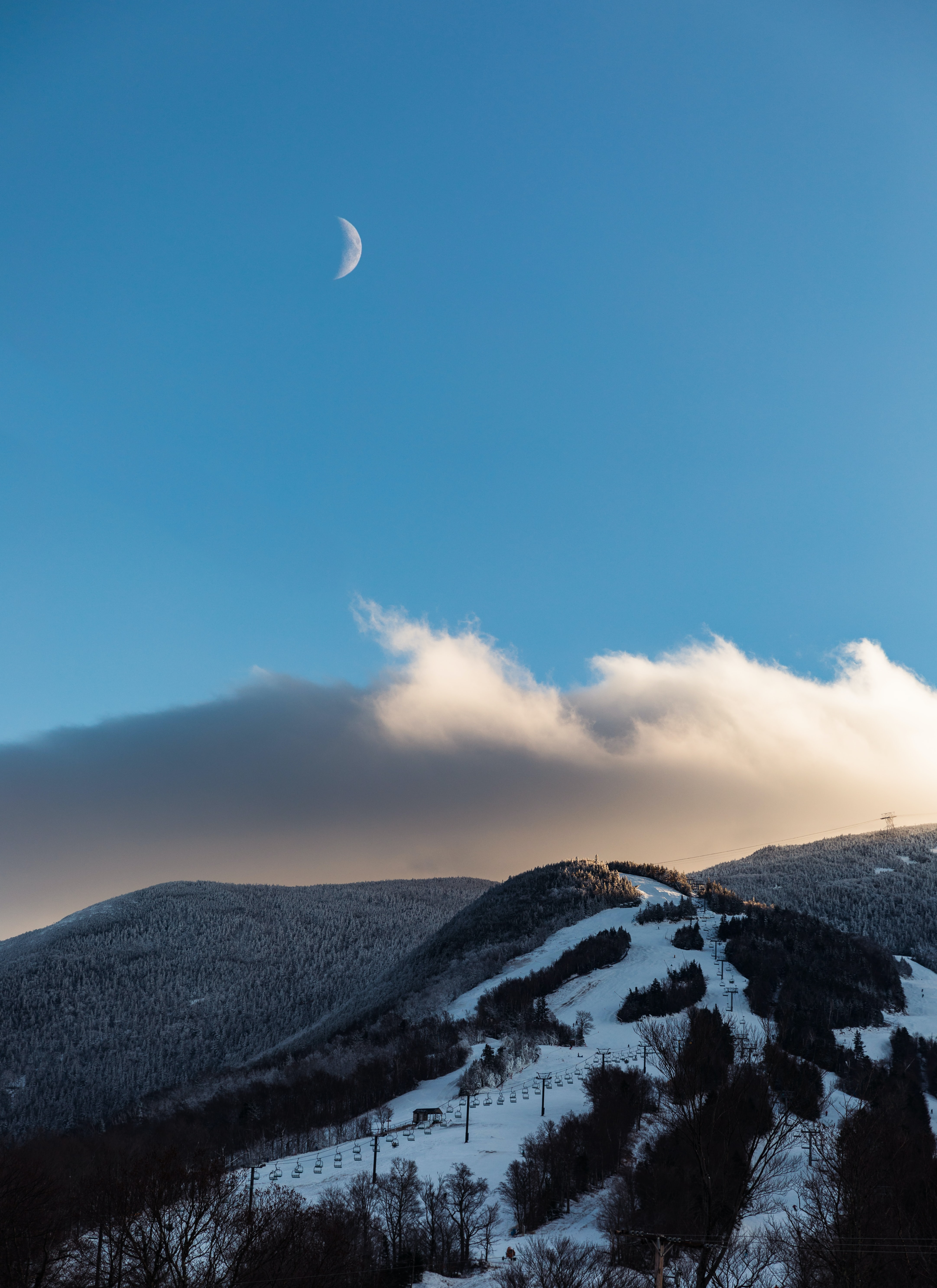 snow and plant covered mountain under crescent moon during daytime