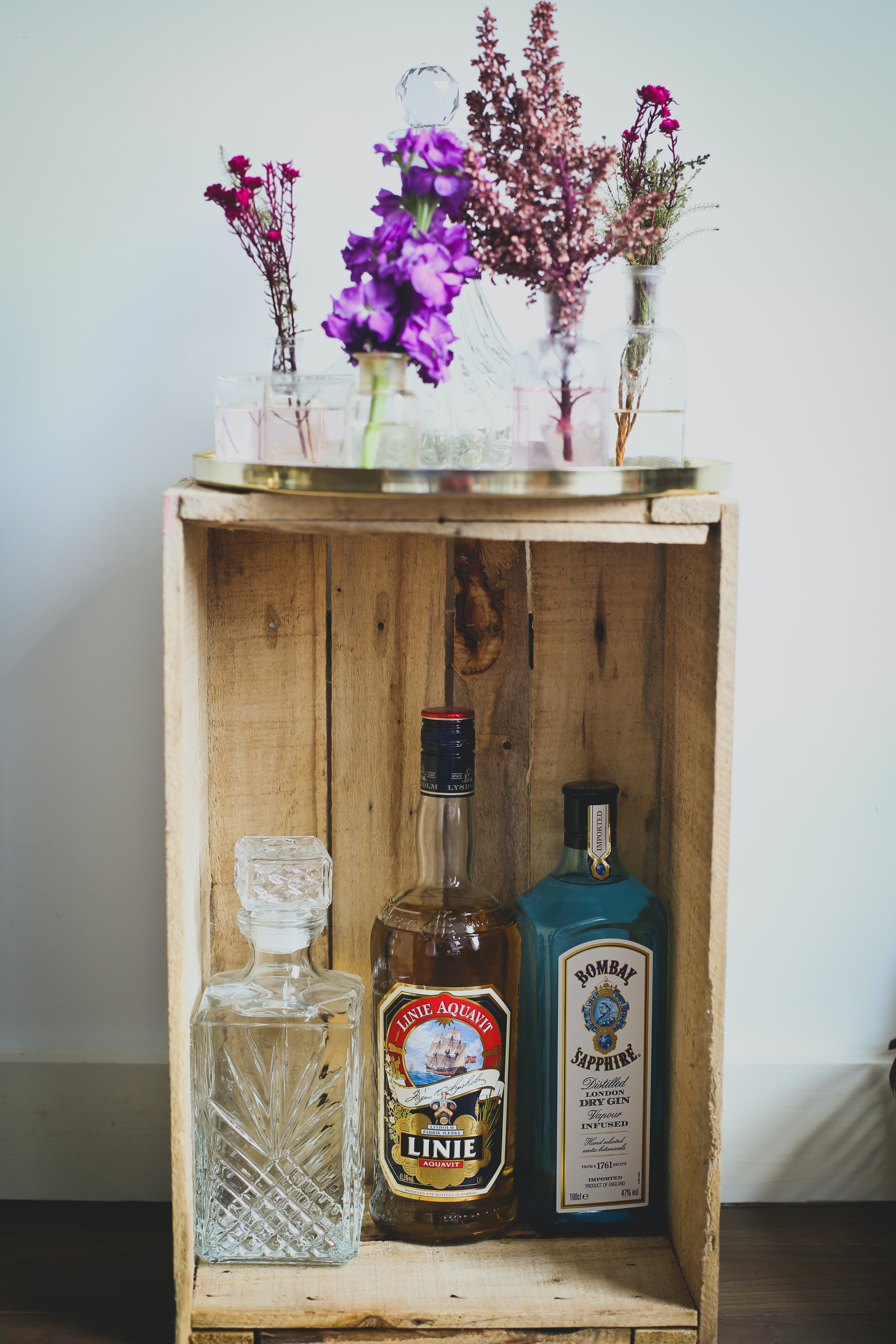 clear glass decanter on wooden rack