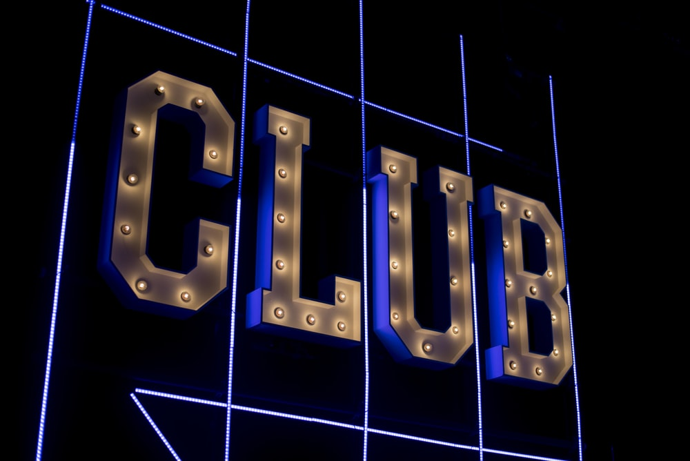 yellow Club logo signage