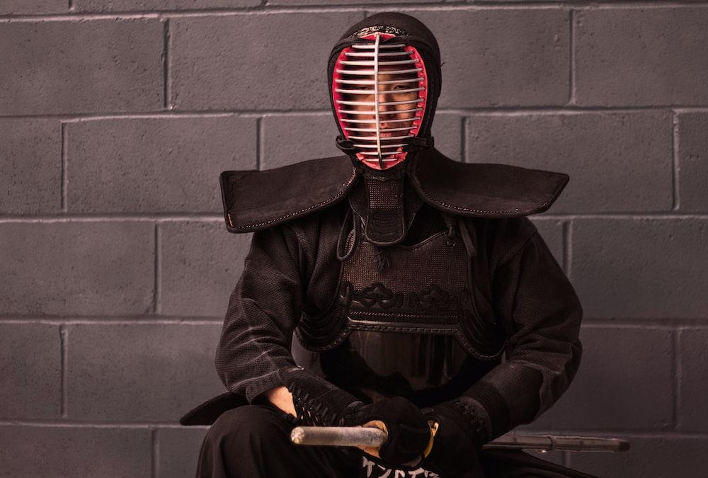 man wearing fencing safety gear set