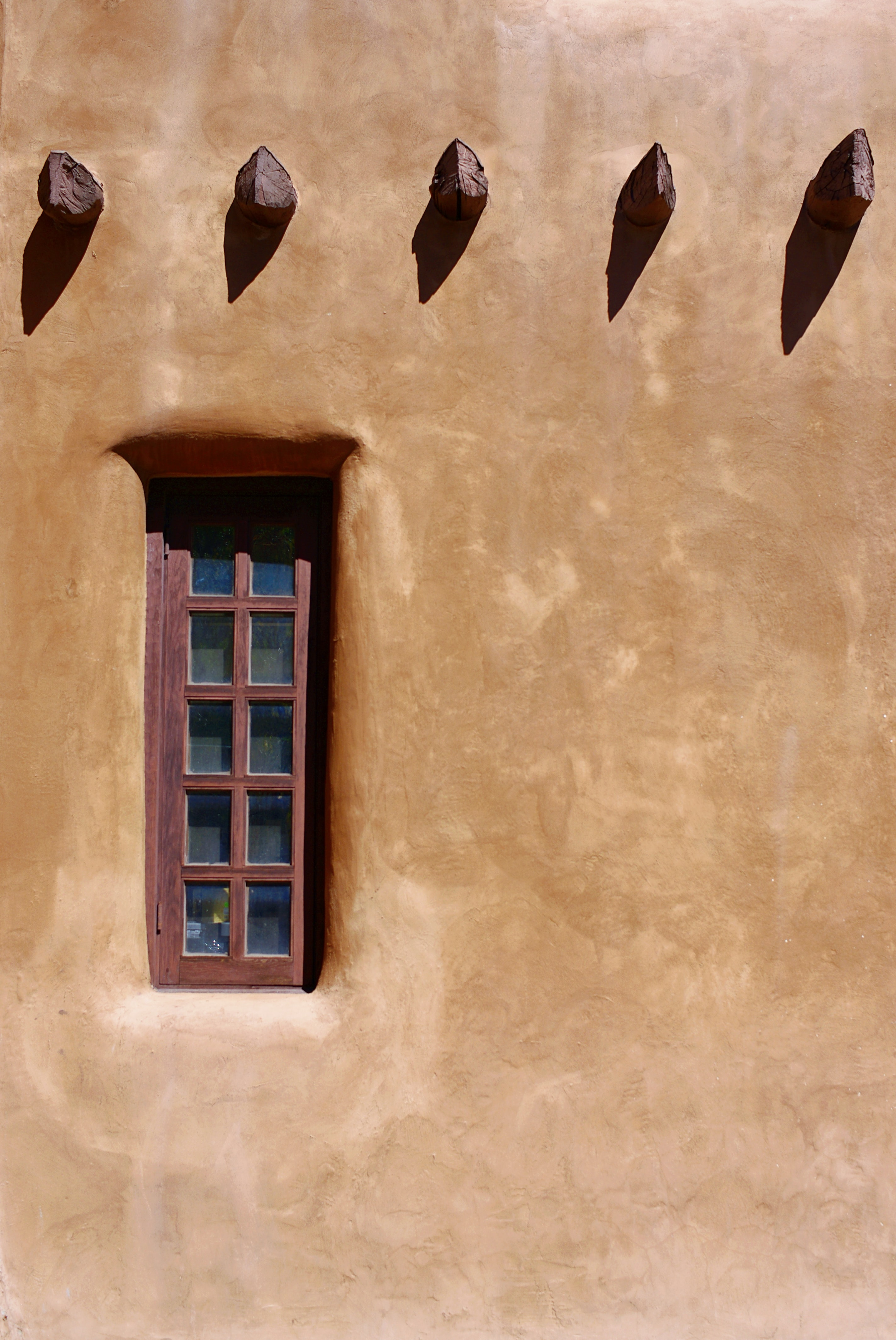 closed window with brown wall paint