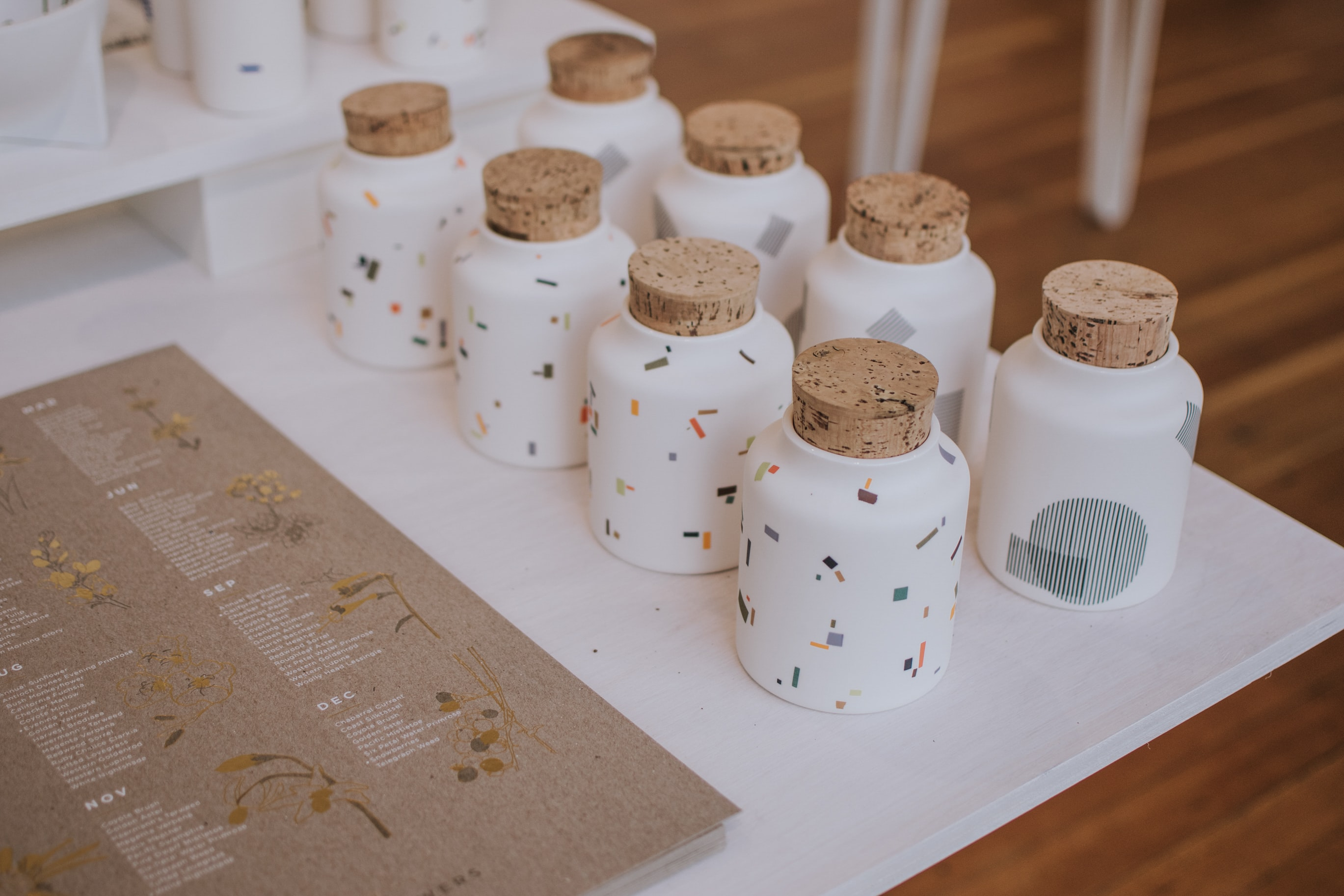 white ceramic containers on white tray
