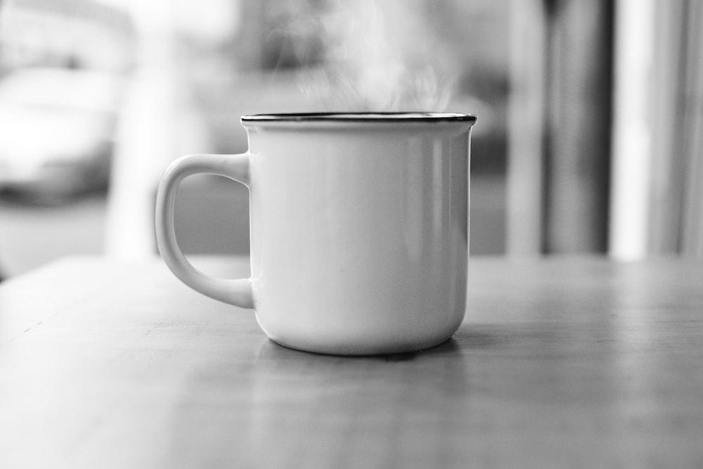 white ceramic mug on table surface