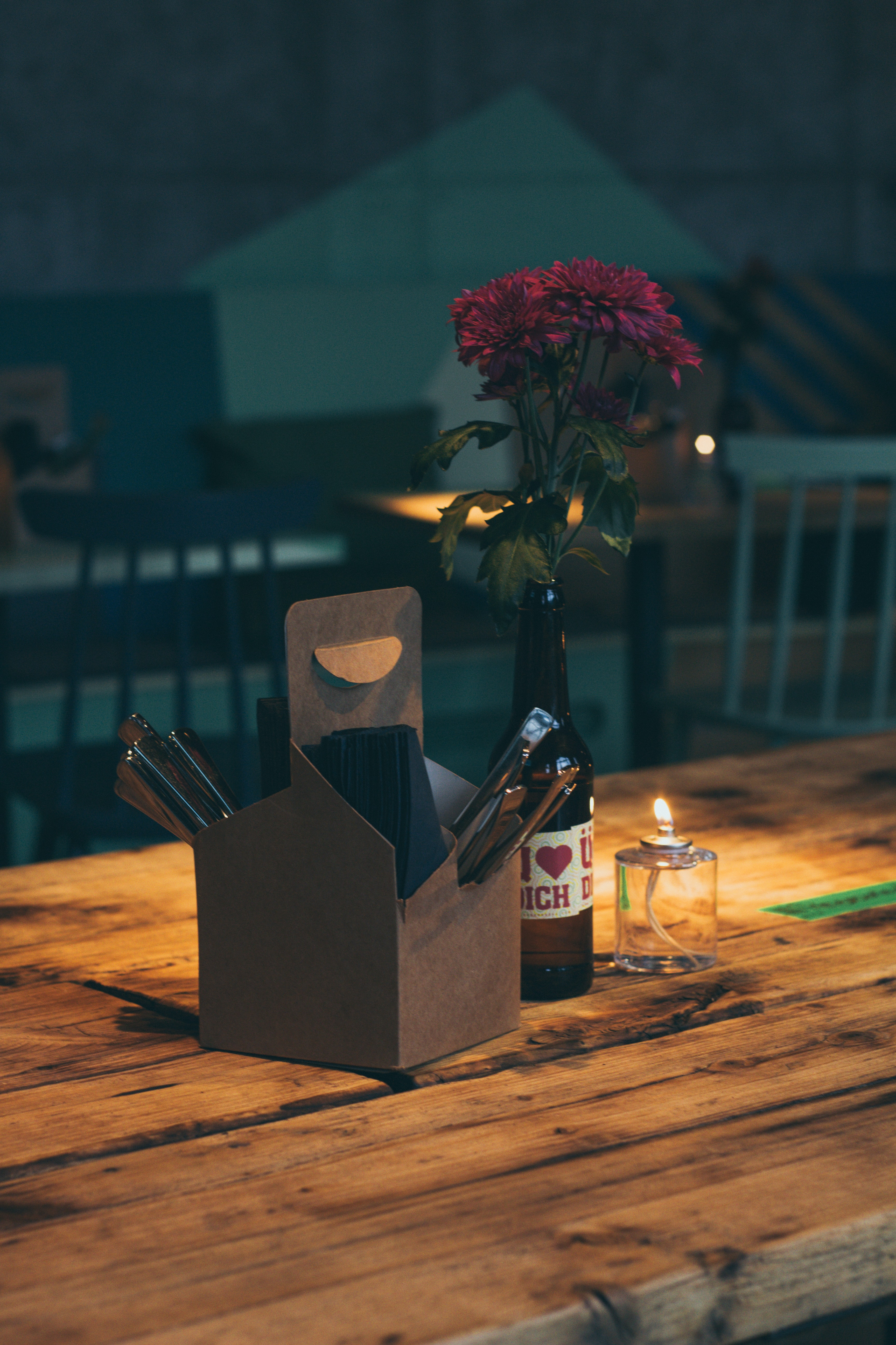 brown box beside bottle on brown wooden table