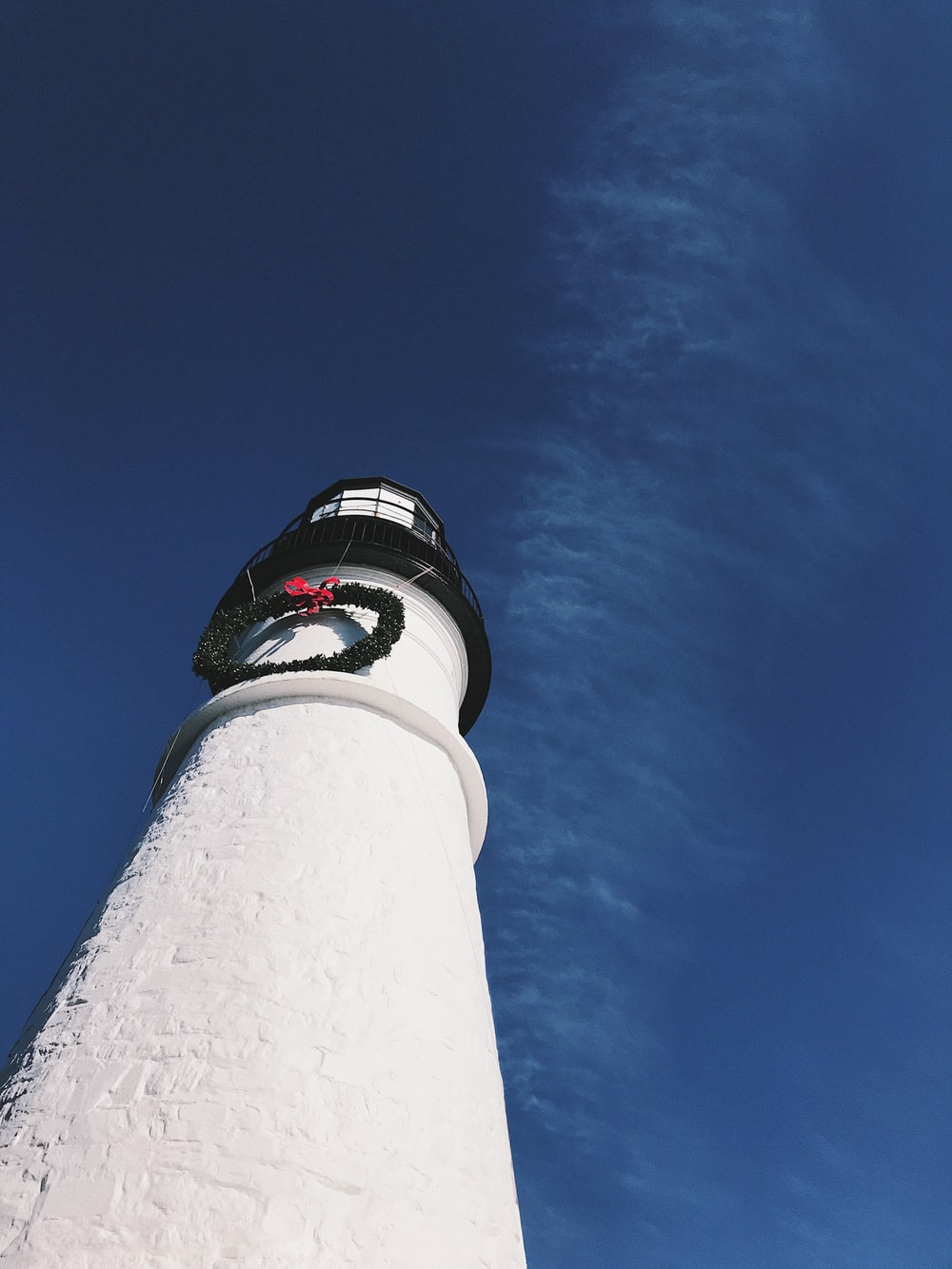 wormseye photography of white light house