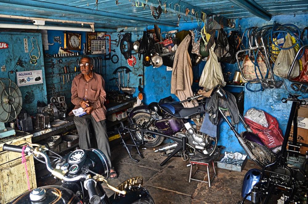 man sitting inside garage