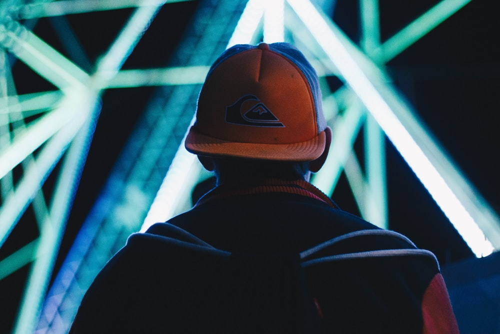selective focus photograph of person wearing cap and jacket