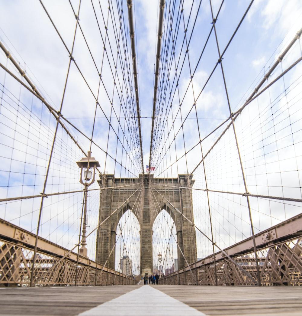 people walking at Brooklyn Bridge during daytime