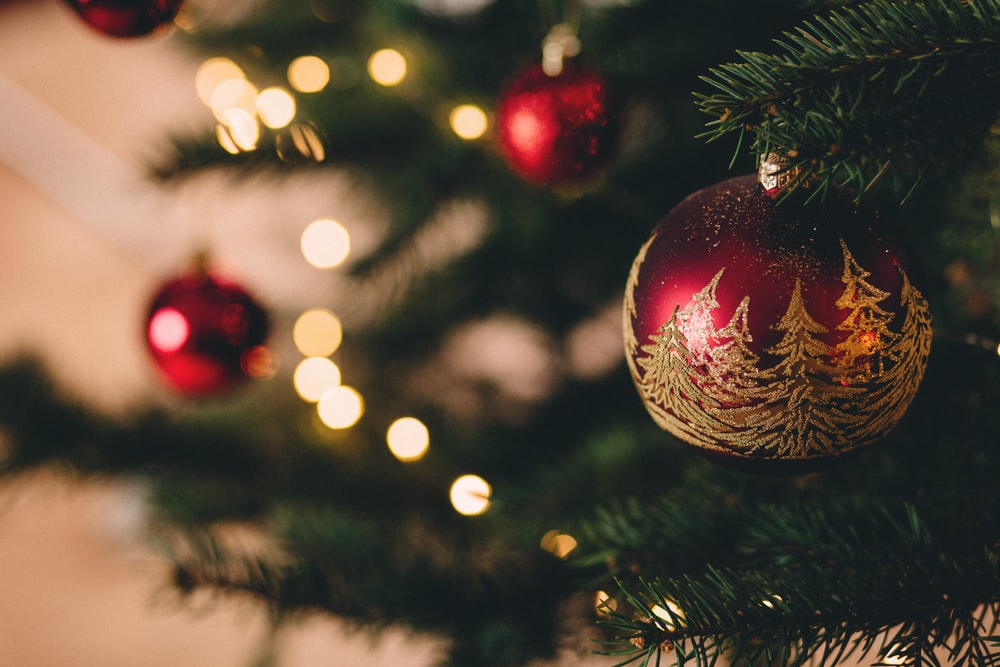 shallow focus photography of red bauble on christmas tree