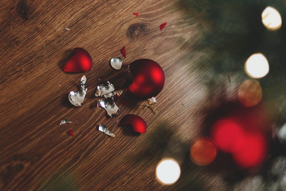 broken red bauble on brown floor