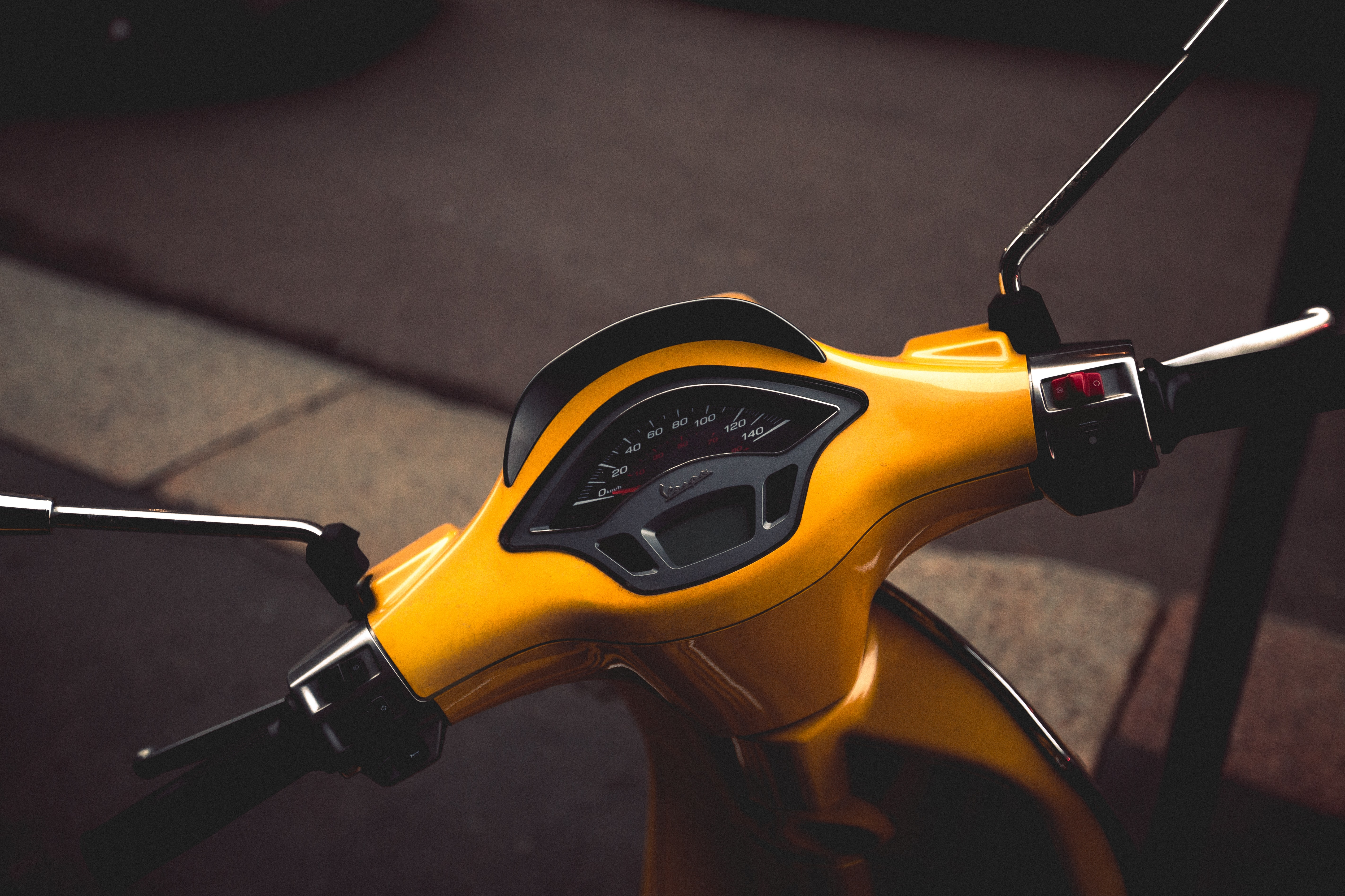 photo of yellow motor scooter